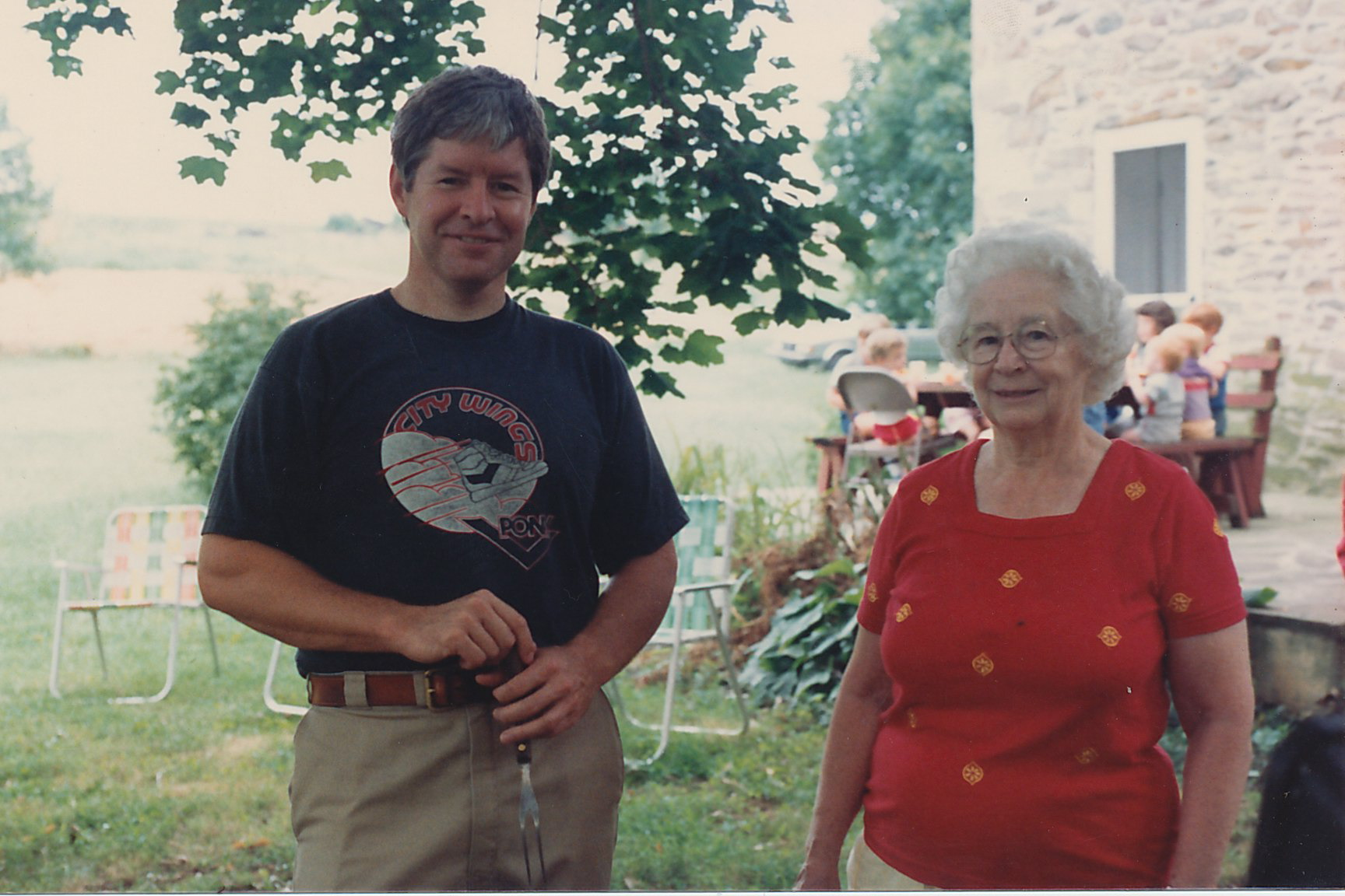 Dad and grandmother in the backyard of her house 1987